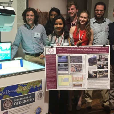 A group of students from the University of Alabama pose next to their project that won first place in the Campus Water Matters Challenge at the 2017 SEC Academic Conference.