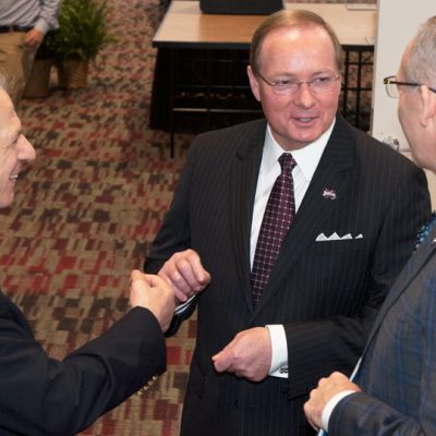 (From left) Award-winning author John Barry, Mississippi State University President Mark Keenum and SEC Commissioner Greg Sankey talk before the start of the 2017 SEC Academic Conference.