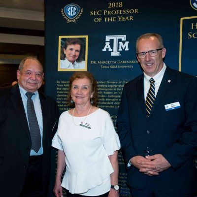 SEC Commissioner Greg Sankey (right) poses with Dr. Marcetta Darensbourg and her husband at the 2018 SEC Award Dinner in Destin, FL.