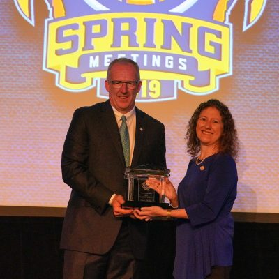 SEC Commissioner Greg Sankey presents Dr. Gabriela Gonzalez, Professor of Physics and Astronomy at Louisiana State University, with the 2019 SEC Professor of the Year award in Destin, FL.