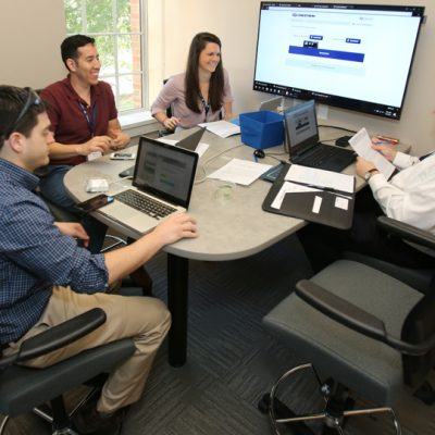 A team puts together its presentation for the 2017 SEC MBA Case Competition held at the University of Florida.