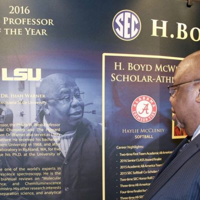 2016 SEC Professor of the Year Dr. Isiah Warner looks at his display at the SEC Awards Dinner in Destin, FL.