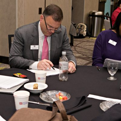 SEC Academic Leadership Development Program participants discuss their in-basket learning exercises during the spring 2015 workshop at Texas A&M University.