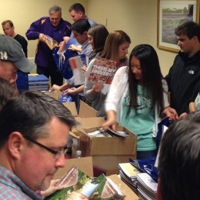 SEC admissions representatives assemble bags with information on each conference university for high school counselors prior to the 2015 SEC College Tour in Northern California.