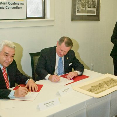 Professor Donato Firrao from the Politecnico di Torino (PdT) (left) and former University of Arkansas Chancellor Dr. David Gearhart sign the engineering student exchange agreement between the PdT and SEC universities in 2010.