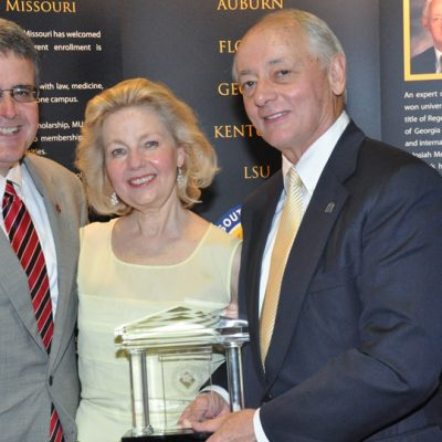 University of Georgia President Jere Morehead poses with Dr. Johnson and his wife at the 2012 SEC Awards Dinner in Destin, FL.