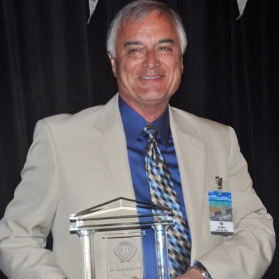 Dr. McSween holds his 2013 SEC Professor of the Year Award following his speech at the 2013 SEC Awards Dinner in Destin, FL.