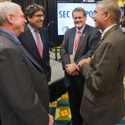 (From left) Former University of Mississippi Chancellor Dan Jones, Vanderbilt University Chancellor Nicholas Zeppos, University of Georgia President Jere Morehead and University of South Carolina President Harris Pastides talk during the SEC Presidents, Chancellors and Provosts Reception at the 2014 SEC Symposium.