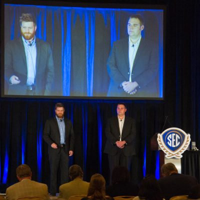 Seth Shumate (left) and Matthew Young from the University of Arkansas present during the student entrepreneurial pitch competition at the 2015 SEC Symposium.