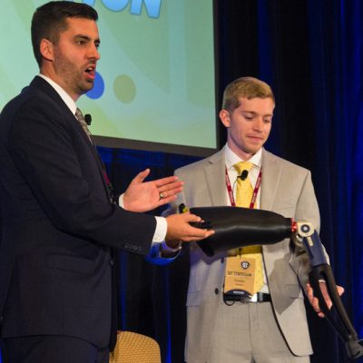 Blake Teipel (left) and Brandon Sweeney from Texas A&M University present during the student entrepreneurial pitch competition at the 2015 SEC Symposium.