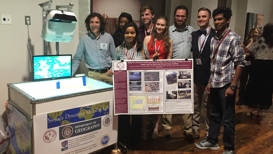 Members of the University of Alabama team pose with their project during Monday night's reception.