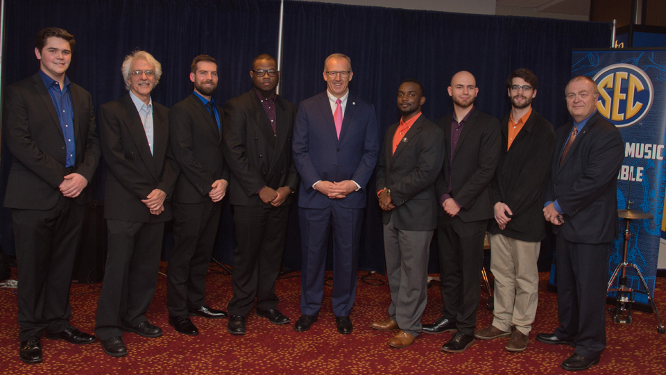 (Left to right) Kirby Davis, David D'Angelo, Erik Alvar, Lazarrus Miller, SEC Commissioner Greg Sankey, Xavier Scaife, Mason Soudelier, Ben Keith, and Michael Pendowski pose for a picture at the annual SEC Legends Dinner.