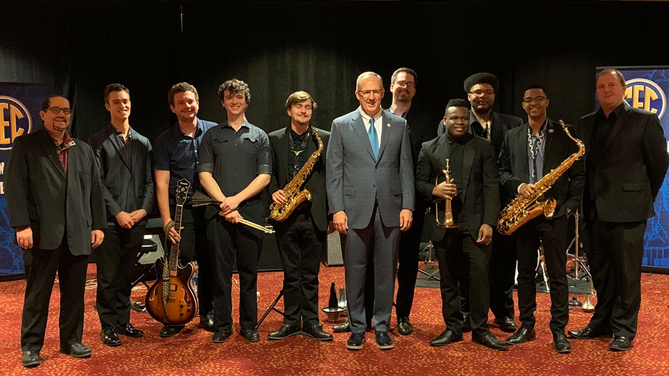 Members of the SEC Student Music Ensemble meet Commissioner Greg Sankey during the 2019 SEC Football Championship Weekend.